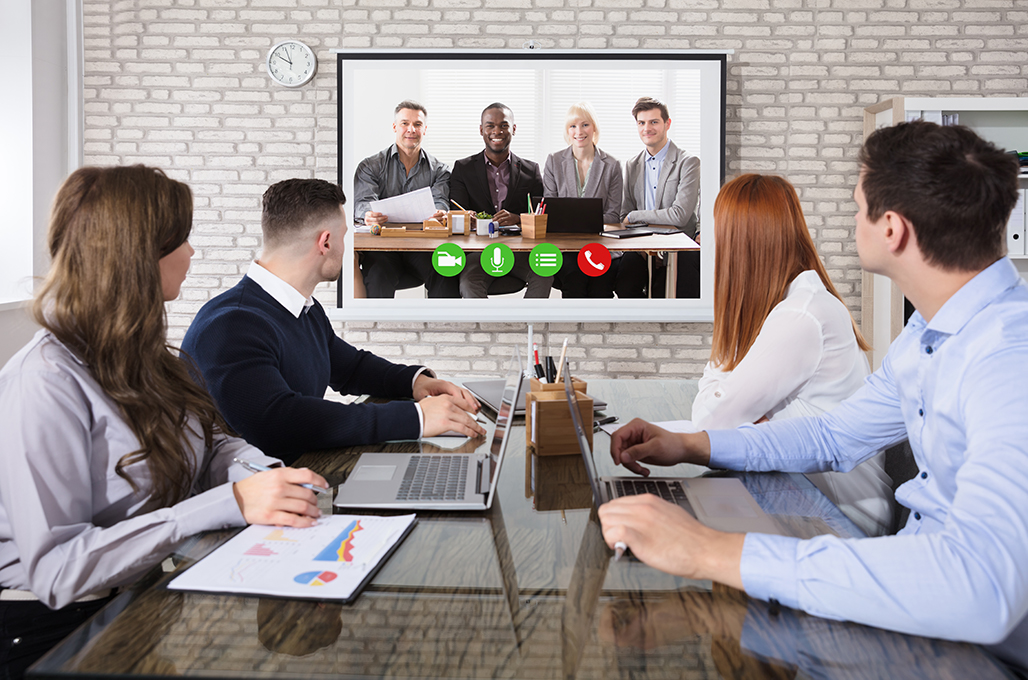 Users gathered around teleconference screen